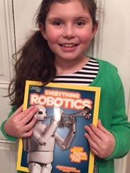 Marcy Fiorentino, 7, of Burlington City, designed a robot for National Geographic's 'Everything Robotics' book