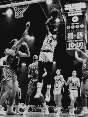 Oscar Robertson shoots for the Cincinnati Royals in 1963.