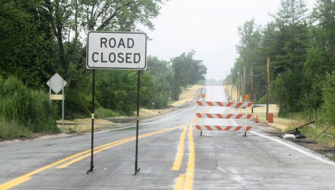 """This """"Road Closed"""" sign moved to a new intersection on Friday when Napier Road between Nine Mile and Ten Mile roads reopened following a three-month paving project."""