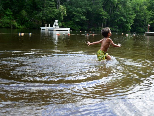 Bailey Apple, 3, plays in Lake Placid at Paris Mountain