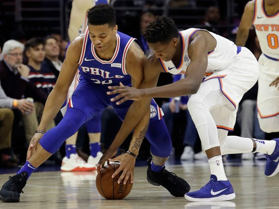 Philadelphia 76ers' Markelle Fultz, left, and New York Knicks' Frank Ntilikina chase the ball during the first half of an NBA basketball game Wednesday, March 28, 2018, in Philadelphia. (AP Photo/Matt Slocum)