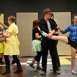 "David Haren (from left), Becka Bentz, Jacob Silbernagel and Natalie Caudel rehearse for the upcoming Regis High School production of ""Guys & Dolls"" March 4."