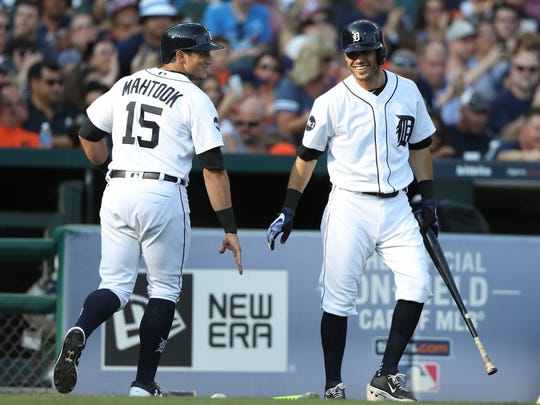 Tigers centerfielder Mikie Mahtook is met by second baseman Ian Kinsler after scoring during the second inning on Saturday, July 15, 2017, at Comerica Park.