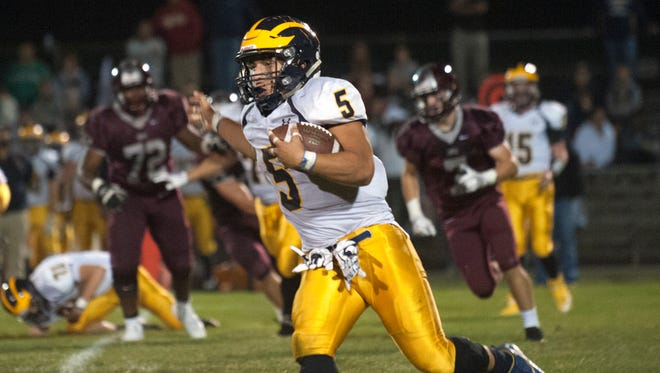 Florence's Mark Pacini runs the ball during the 2nd quarter of Friday night's football game between Holy Cross and Florence played at Holy Cross High School in Delran.  09.29.17