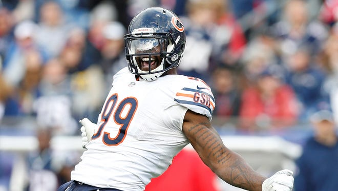 Chicago Bears defensive end Lamarr Houston (99) celebrates after sacking New England Patriots quarterback Jimmy Garoppolo (not pictured) during the fourth quarter at Gillette Stadium.  T