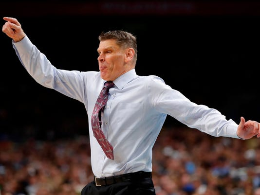 Loyola-Chicago head coach Porter Moser reacts during the second half in the semifinals of the Final Four NCAA college basketball tournament against Michigan, Saturday, March 31, 2018, in San Antonio. (AP Photo/Charlie Neibergall)
