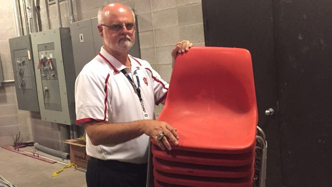 Chuck Crabb, IU facilities director, has a stack of the chairs. Is it one of these? Who knows?