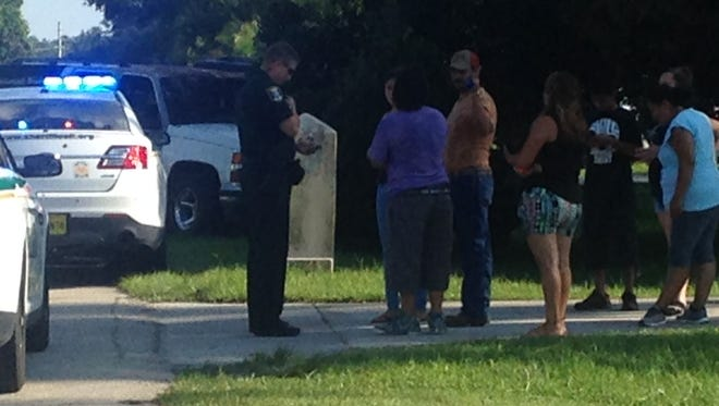 Family and deputies at the scene of the shooting