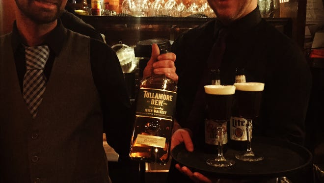 (l-r) Keith Moore and Brady White at Skull's Rainbow Room in Printers Alley. Moore, a Dublin native, holds a bottle of one of his favorite Irish whiskey brands, Tullamore D.E.W..