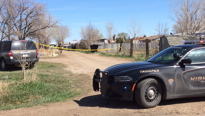 Police seal off an area two blocks from the home of 1-year-old Kenzley Olson, who was found dead in Poplar.