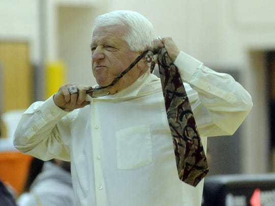 St. Augustine basketball coach Paul Rodio shows his emotion during Monday's win over Egg Harbor.