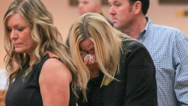 Tiffney Osborne, center, mother of the 14-year-old suspect in Wednesday's Townville Elementary School shooting, walks in with family before her son's detention hearing Friday at the Anderson County Courthouse in Anderson.
