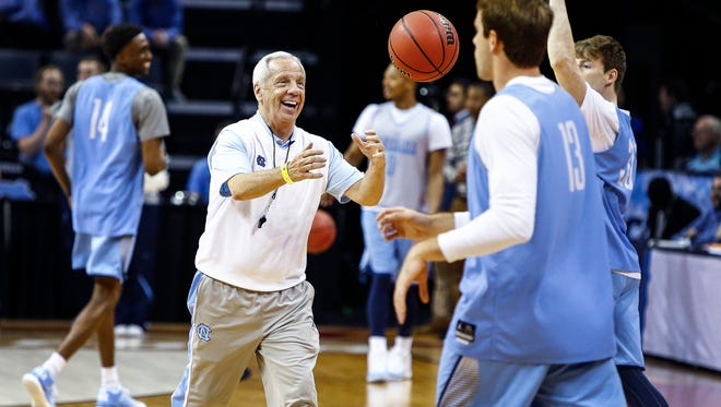 University of North Carolina head coach Roy Williams (middle) jokes with his team during the NCAA South Regional Sweet Sixteen practice day at the FedExForum. The No. 1 seed Tarheels will take on No. 4 seeded Butler  in Friday's early game.