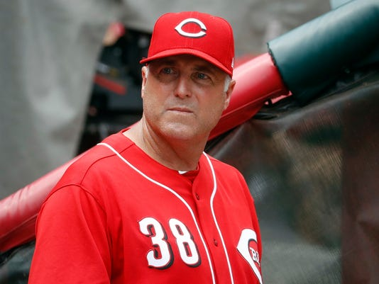 "FILE - In this July 20, 2017, file photo, Cincinnati Reds manager Bryan Price works in the dugout in the ninth inning of a baseball game against the Arizona Diamondbacks in Cincinnati. ""Having a fully healthy Homer Bailey, Brandon Finnegan and Anthony DeSclafani, there's a lot of reason to believe we've finally got there,"" manager Bryan Price said(AP Photo/John Minchillo, File)"