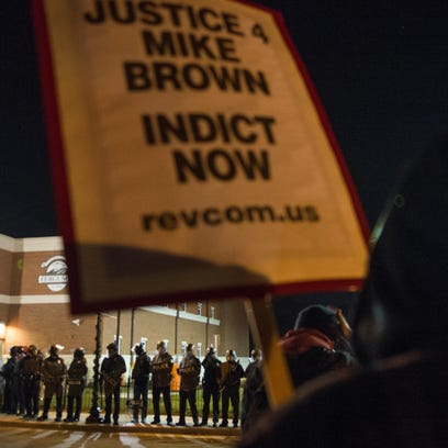 Police block protesters from the street at the Ferguson