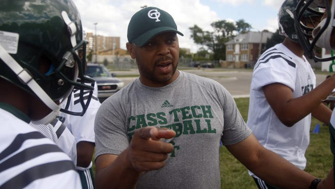 Detroit Cass Tech football coach Thomas Wilcher talks to his players during practice Aug. 14, 2013.