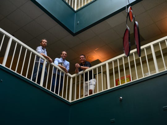 From left, Kirk Davis, Nick Simpson and Bret Davis pose for a photo inside of the City Center on Salisbury's Downtown Plaza. The business partners have a contract to purchase the building which houses Roadie Joe's and other businesses.
