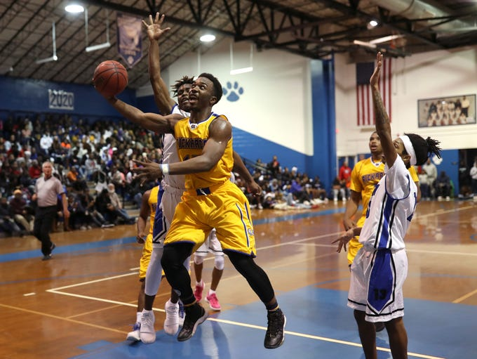 Rickards' Gentry Sparks lays the ball up and in while