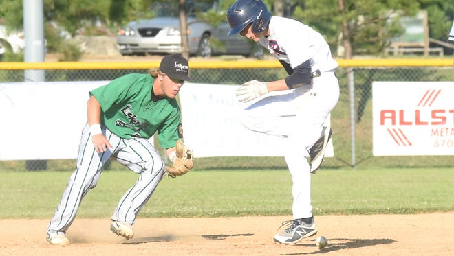Lockeroom second baseman Caleb Johnson fields the ball as Rogers' Cole Richardson avoids being hit by the grounder during action Wednesday night at Cooper Park.