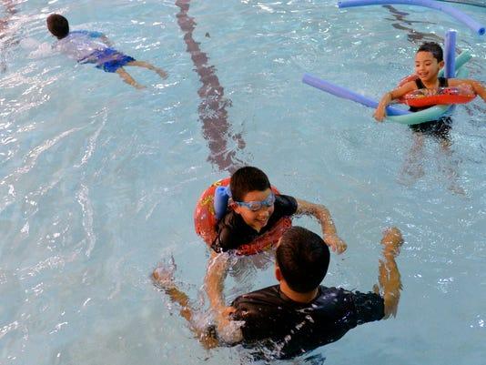 1-YDR-CD-121115-family-swim