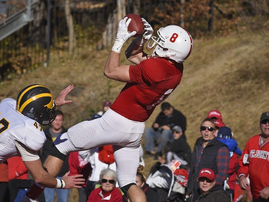 Matt Miller leaps to make a catch during the Johnnies' win over Gustavus last season.