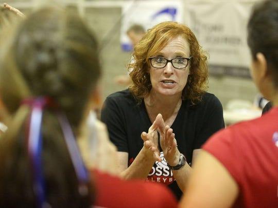Crosshill Christian Head Coach Julie Bennett talks with her team during a timeout during their game with Country Christian on Tuesday, Oct. 20, 2015, in Turner, Ore.