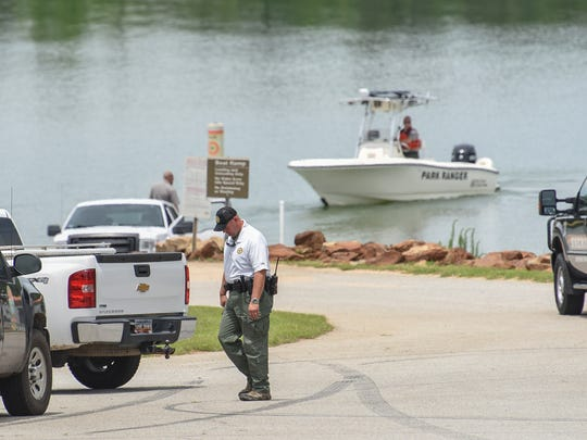 Sgt. Rhett Barwick of South Carolina Department of Natural Resources walks to his vehicle following an Anderson County Sheriff Office deputy accidental death in Lake Hartwell near Singing Pines Recreation Area in Anderson County on Thursday.