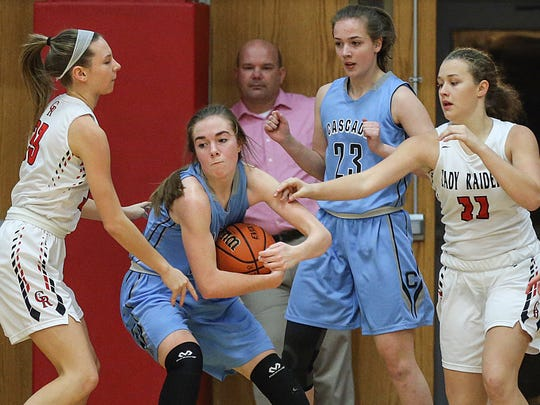 Cascade Cadet Emelia Bryant protects the ball as her sister Sophia Bryant gets open for a pass, during their game against the Cardinal Ritter Raiders at Cardinal Ritter, Indianapolis, Tuesday, Dec. 5, 2017.