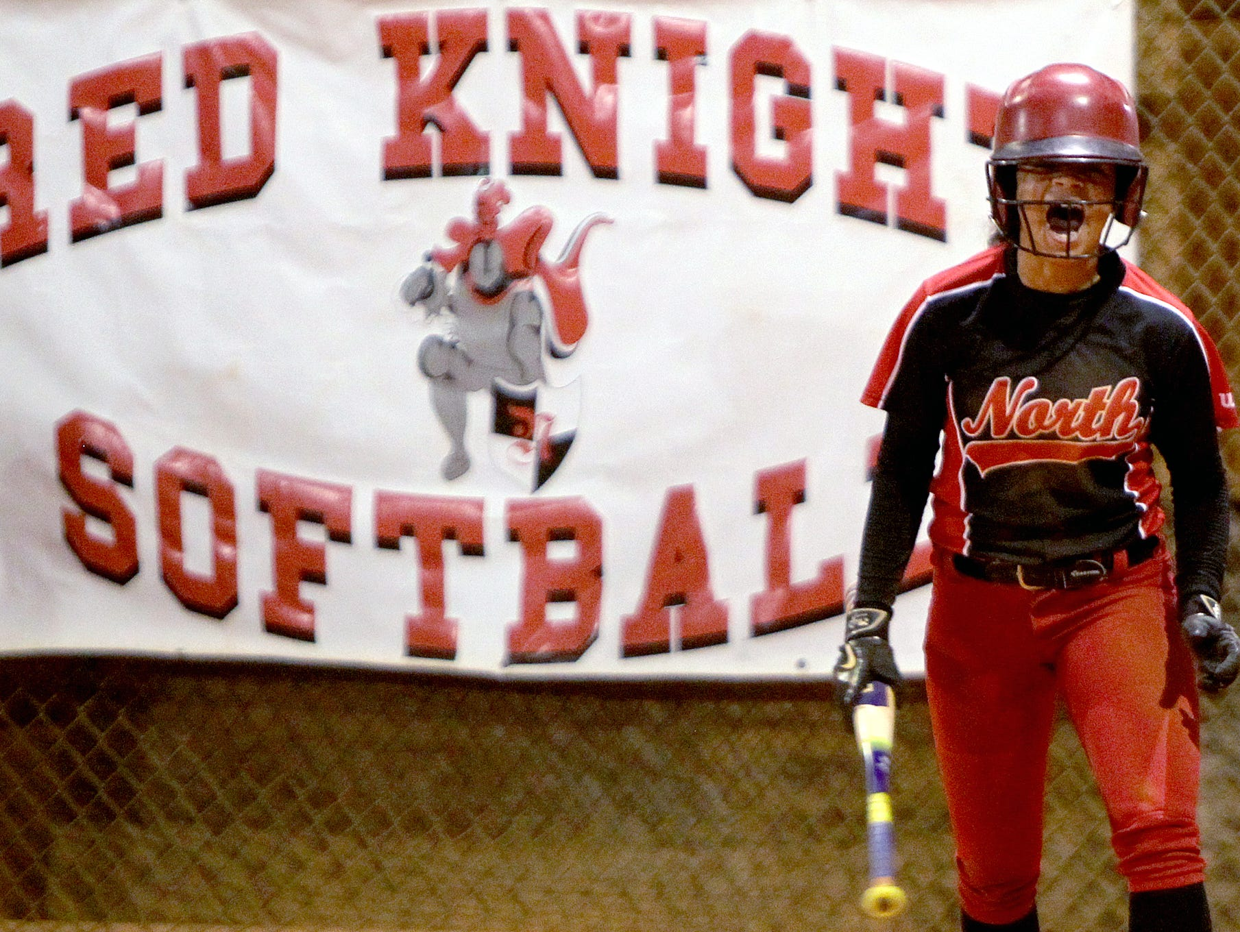 North's Sajarie Jones hollers after crossing the plate Friday at the 6A-3 softball final against Auburndale.