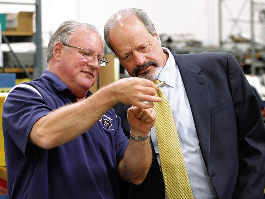 Matt Keats, president and co-owner of Keats Southwest, last year showed El Paso Mayor Oscar Leeser some of the parts manufactured at his factory during a tour. A recent federal trade report profiles the El Paso company and 49 others in each state as part of the Obama administration's push for a proposed, 12-nation free-trade agreement.