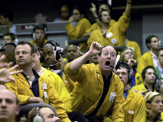 FILE - In this Sept. 16, 2003 file photo, clerks shout in the Euro Dollar Futures pit at the Chicago Mercantile Exchange. Most pits in Chicago and New York where traders bet on future prices of palladium and gold, cattle and corn and dozens of other commodities are expected to close for good on Monday, July 6, 2015. (AP Photo/Anne Ryan, File)