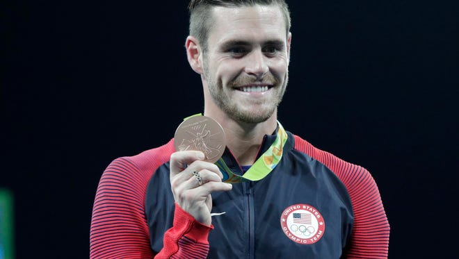 David Boudia (USA) celebrates winning the bronze medal in the men's 10m platform diving event during the Rio 2016 Summer Olympic Games at Maria Lenk Aquatics Centre.