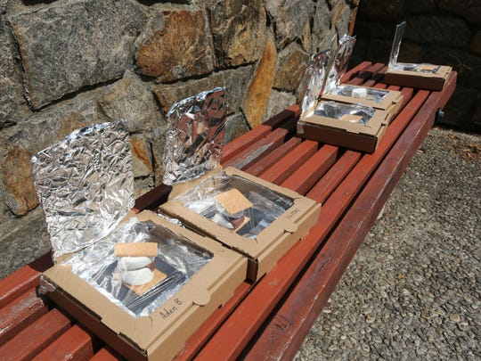 """""""Solar ovens"""" sit in the sun at the Will Library in"""