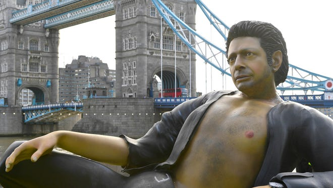 "A 25-foot statue of actor Jeff Goldblum has taken over London's Potters Field Park in commemoration of the 25th anniversary of ""Jurassic Park."""