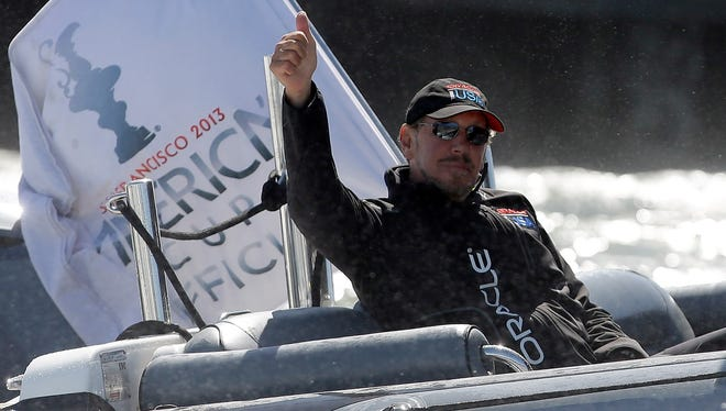 Oracle CEO Larry Ellison reacts after Oracle Team USA beat Emirates Team New Zealand in race 17 of the America's Cup Finals on September 24, 2013 in San Francisco.
