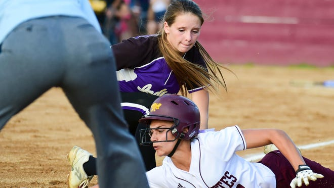 Ankeny runner Peyton Daugherty is tagged out trying to get back to third base during Tuesday's game against visiting Indianola. The eighth-ranked Hawkettes ended their season with a 4-1 loss in a Class 5A regional final.