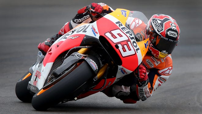 Marc Marquez rounds turn 4 during the first practice session for the Red Bull Indianapolis Grand Prix Friday afternoon at the Indianapolis Motor Speedway.