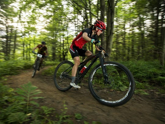 Lea Davison races during the Wednesday night mountain bike races held at Catamount Outdoor Family Center in Williston on July 27. BRIAN JENKINS/for the FREE PRESS