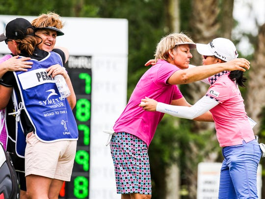 Barb Mucha of Orlando, Florida, leans in to hug Sue Kim, Langley, British Columbia, at the end of play. Mocha's and Perry's caddy's do the same.  2016 Chico's Patty Berg Memorial Round 3 Saturday, April 16, 2016 at Cypress Lake Country Club.