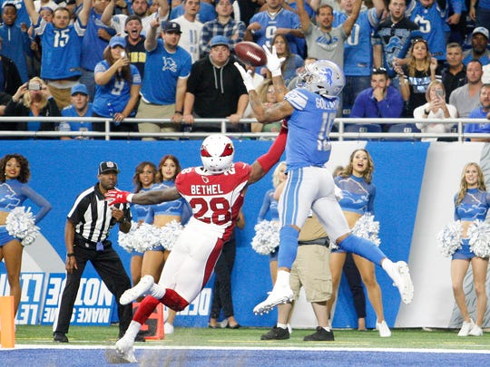 Lions rookie receiver Kenny Golladay makes his first NFL touchdown catch in the fourth quarter against Cardinals cornerback Justin Bethel at Ford Field on Sept. 10, 2017.