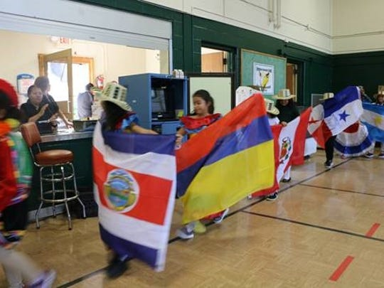 Children parading with all 20 flags representing the