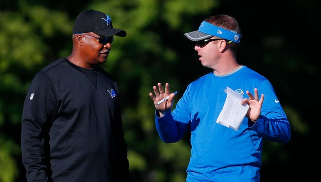 Detroit Lions coach Jim Caldwell, left, talks with general manager Bob Quinn on Aug. 8, 2016.