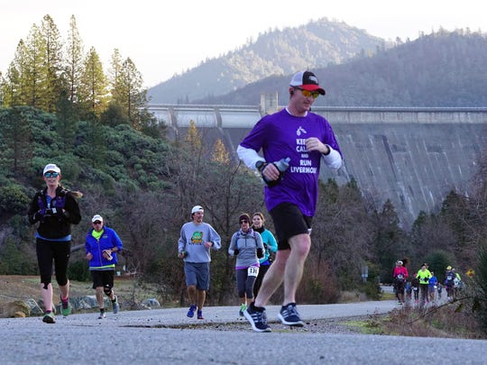 Runners head down the Sacramento River trail as they participate in the Redding Marathon on Sunday morning.