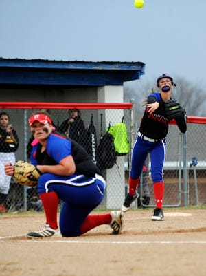 Zane Trace's Alyx Chaffin throws the ball to first during Zane Trace's game against Paint Valley Monday at Zane Trace High School. The Pioneers defeated the Bearcats 3-0.