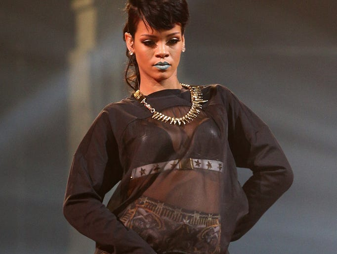 Rihanna is the first American Music Awards icon. Here's a look back at the pop star and her many looks.