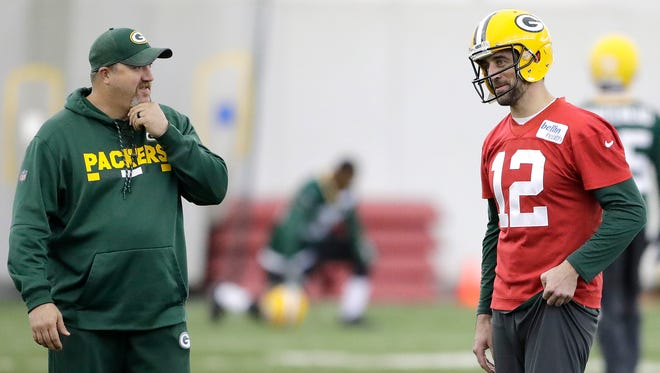 Green Bay Packers quarterback Aaron Rodgers (12) talks with quarterbacks coach Alex Van Pelt during practice at the Don Hutson Center on Dec. 13, 2017.
