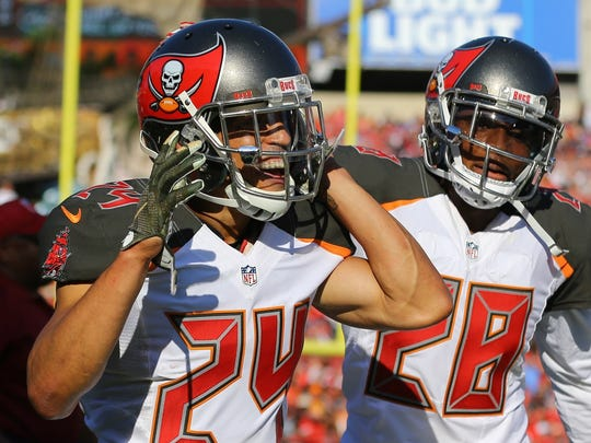 Nov 13, 2016; Tampa, FL, USA; Tampa Bay Buccaneers cornerback Brent Grimes (24) reacts with cornerback Vernon Hargreaves (28) against the Chicago Bears at Raymond James Stadium. The Buccaneers won 36-10. Mandatory Credit: Aaron Doster-USA TODAY Sports