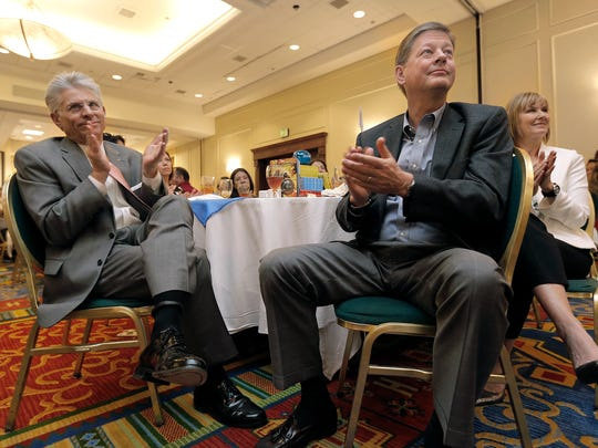 WestStar Bank President and Chief Operating Officer David Osborn, right, and Chairman and CEO Rick Francis, left, applaud the fundraising efforts of companies and individuals during the United Way's 2016 Appreciation Luncheon on Wednesday at the El Paso Marriott.