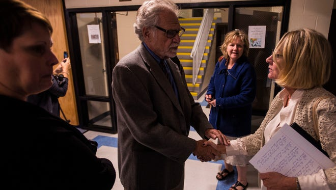 David Boulanger, a former high school English teacher who is the Vermont-NEA field representative for Chittenden County, shakes hands with mediator Cynthia Jeffries after the South Burlington School Board and teachers came to a tentative agreement in the early hours of Wednesday morning, Oct. 4, 2017, at Frederick H. Tuttle Middle School after about ten hours of negotiations that started Tuesday night.