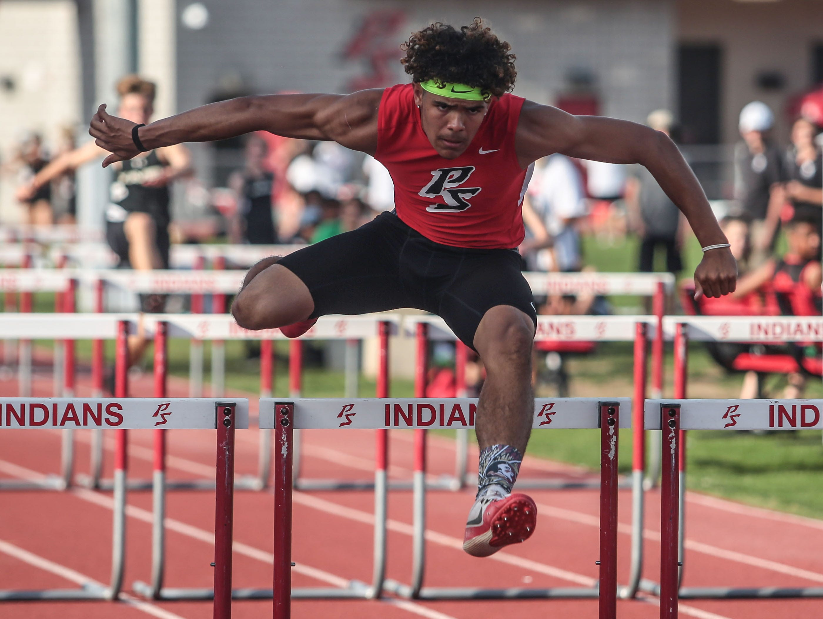 Palm Springs' sophomore Andrew Clark is first in the 100m hurdles during a track meet with Xavier College Prep on Thursday, March 16, 2017 in Palm Springs.